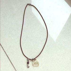 Juicy Couture brown cord necklace with charms